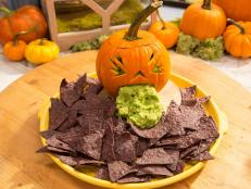 The Kitchen has the ultimate gross-out presentation idea for your next Halloween table. Don't just serve guacamole. Serve it in a sick Guacamole Jack-o'-Lantern!