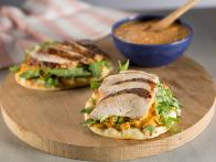 Spice-Rubbed Chicken Breast on Toasted Pita with Piquillo-White Bean Hummus and Arugula Salad