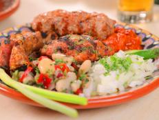 <p>While still in college, Chef Nina Manchev opened her Bulgarian restaurant at the age of 23. The mixed grill plate with three different types of Bulgarian sausage captured Guy's heart. Topped with dry cured Bulgarian charcuterie, the Thracian Clay Pot was another one of Guy's favorites.</p>