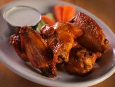 "<p>This taphouse is known for their selection of hard apple ciders, but the food in their kitchens is not to be missed either. Chef Ryan Hickey incorporates the cider into every dish, including the hot wings, which are made with the Dirty Mayor, a ginger-infused cider. ""This wing sauce is outrageous,"" Guy said.</p>"